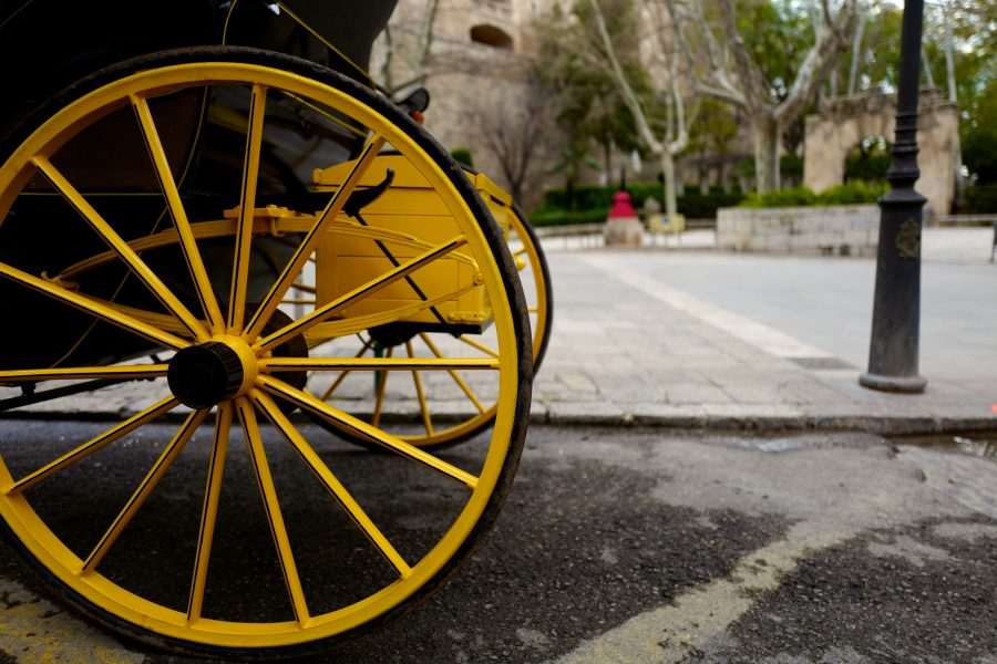 Yellow wheels from a carriage parked up