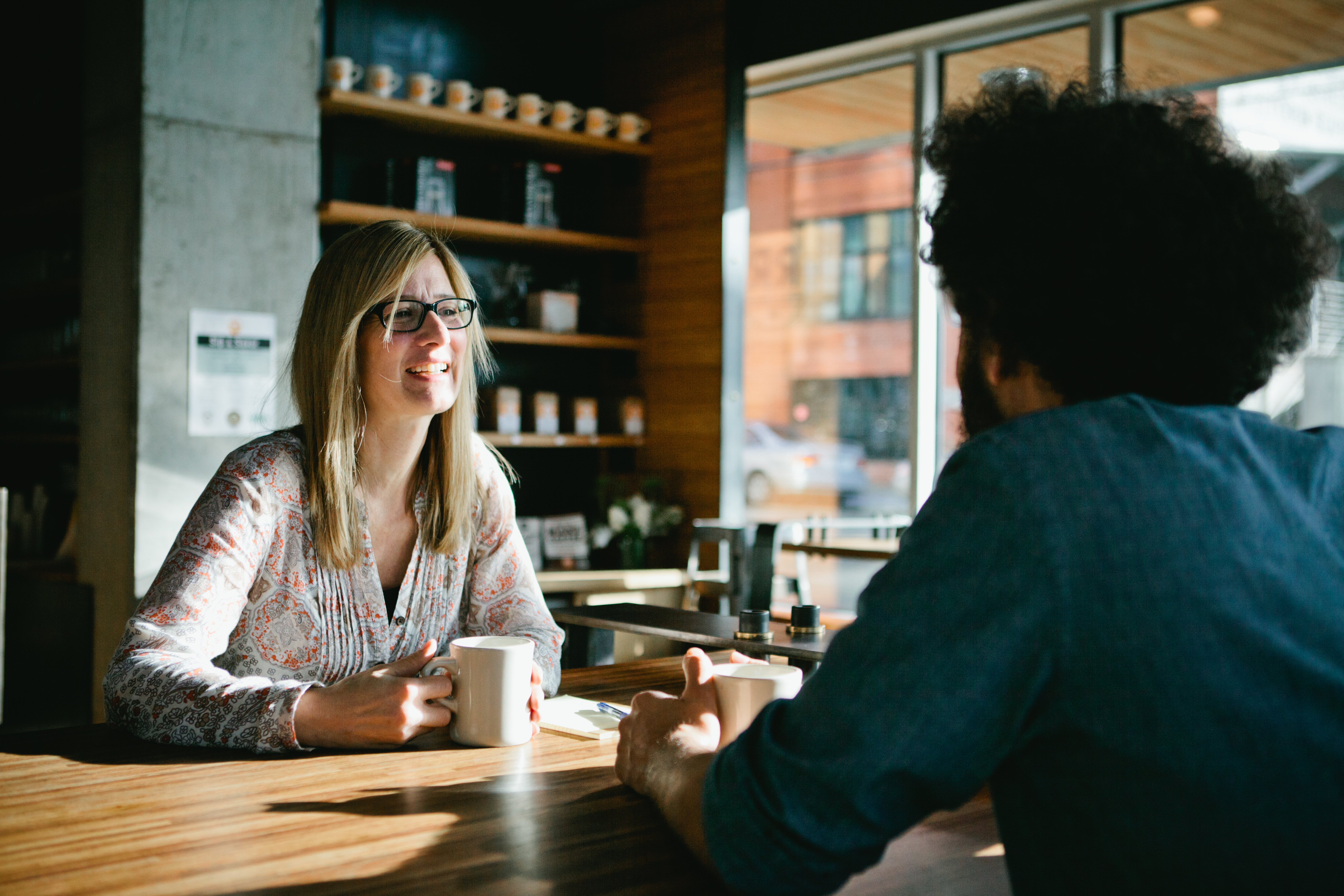 Man and woman having a drink together in a coffee shop