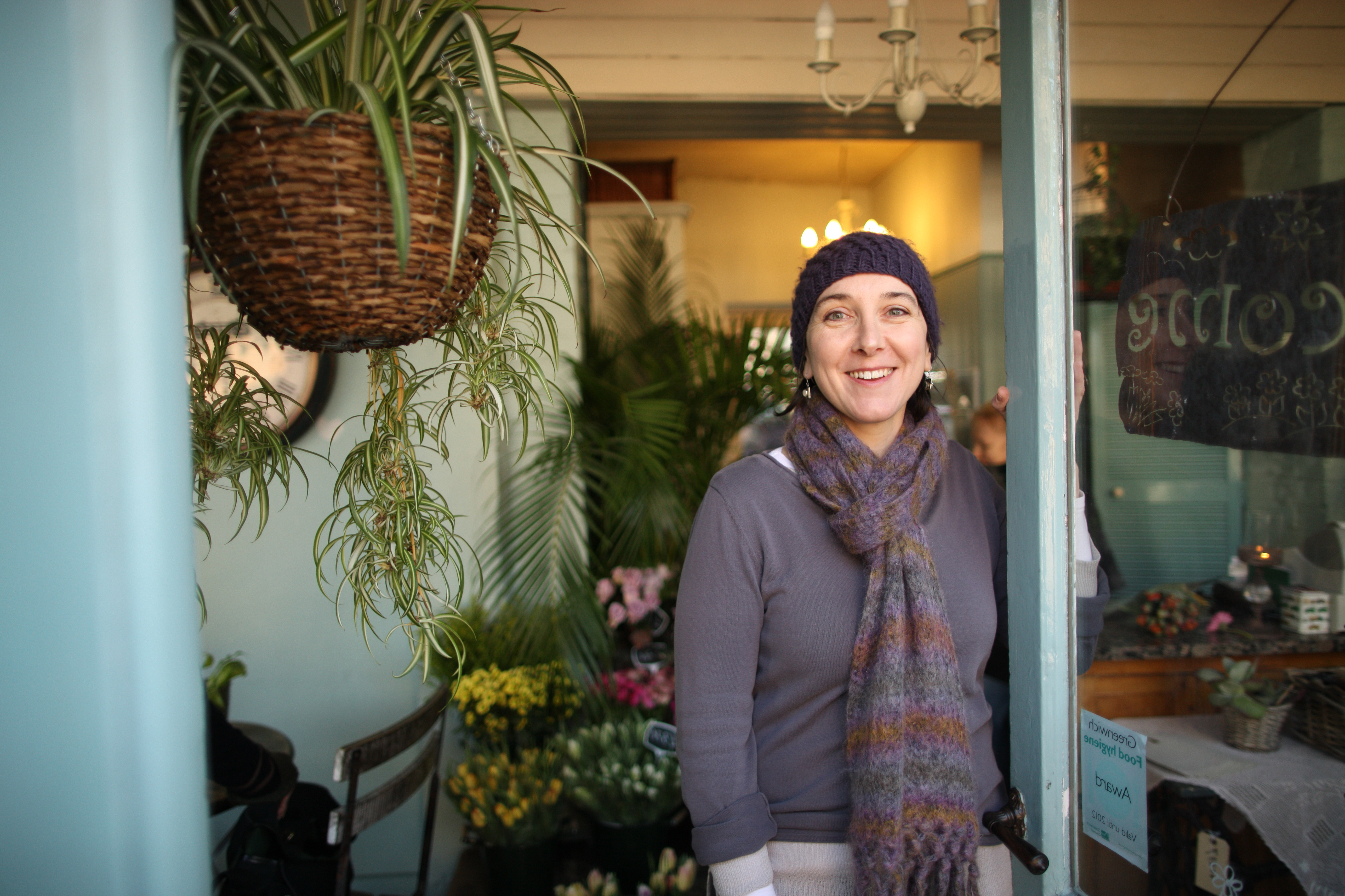 Woman stood at florist shop door