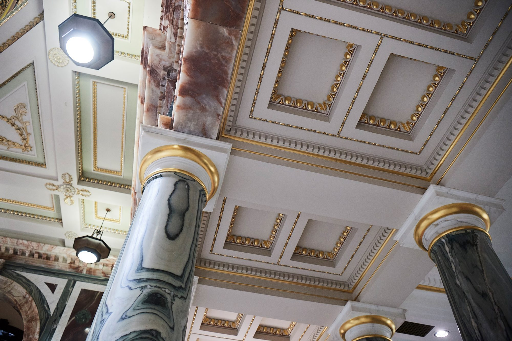 Pillar and intricate ceiling detail of the Marble Hall, Norwich