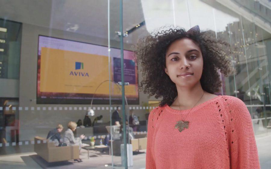 Woman stood outside Aviva office in London
