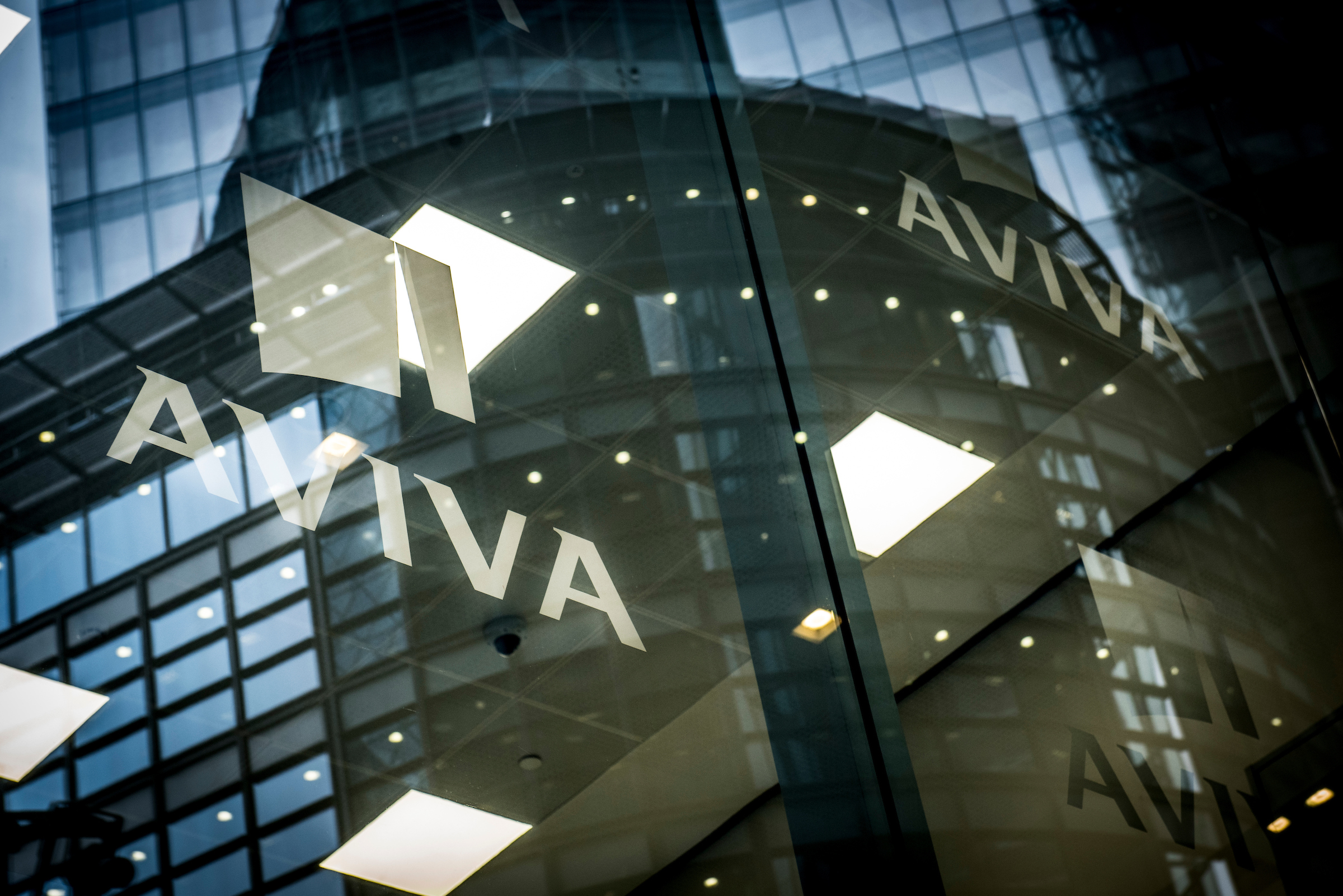 Reflection of Aviva logo in glass buildings