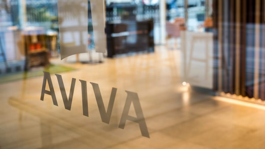 Aviva logo frosted onto glass, view of room beyond