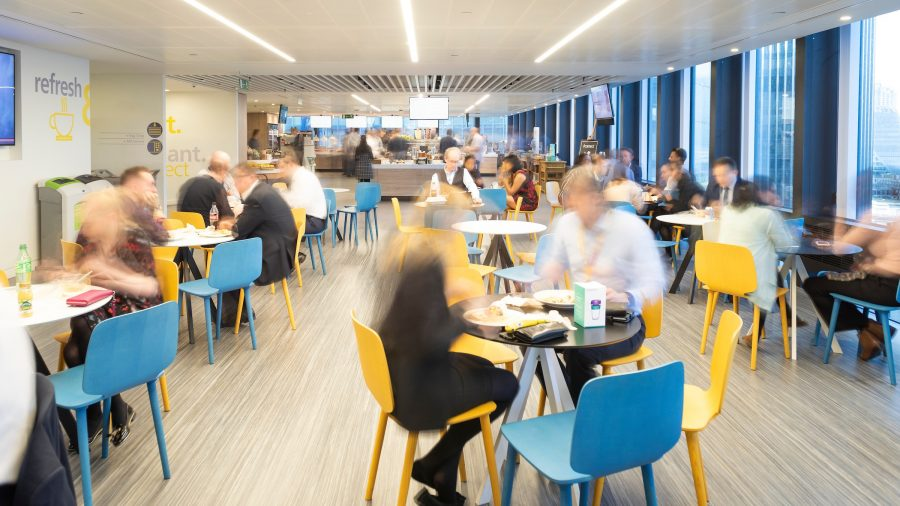 Office canteen with lots of people at tables