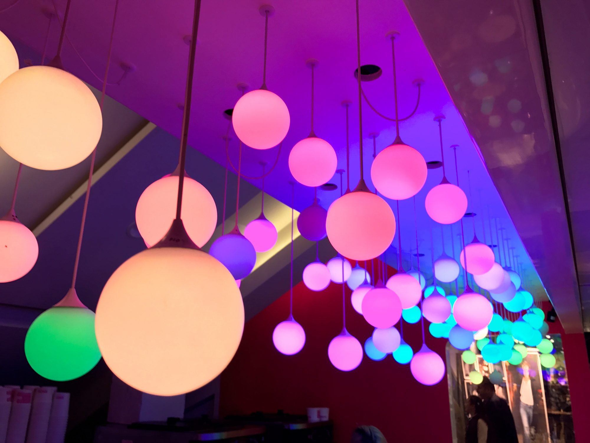 Coloured lights hanging from the ceiling