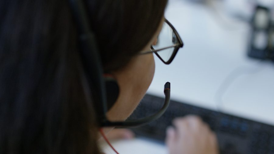 Close up of woman wearing a headset from a side angle