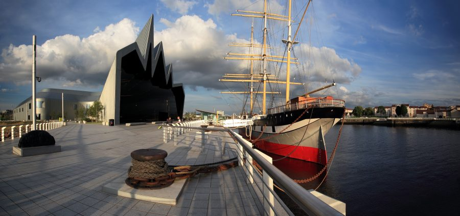 View of a ship docked outside the ultramodern Riverside Museum in Glasgow, Scotland