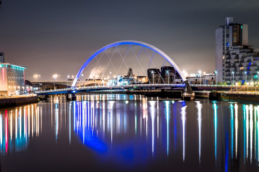 Nighttime shot of the Clyde Arc bridge in Glasgow, Scotland