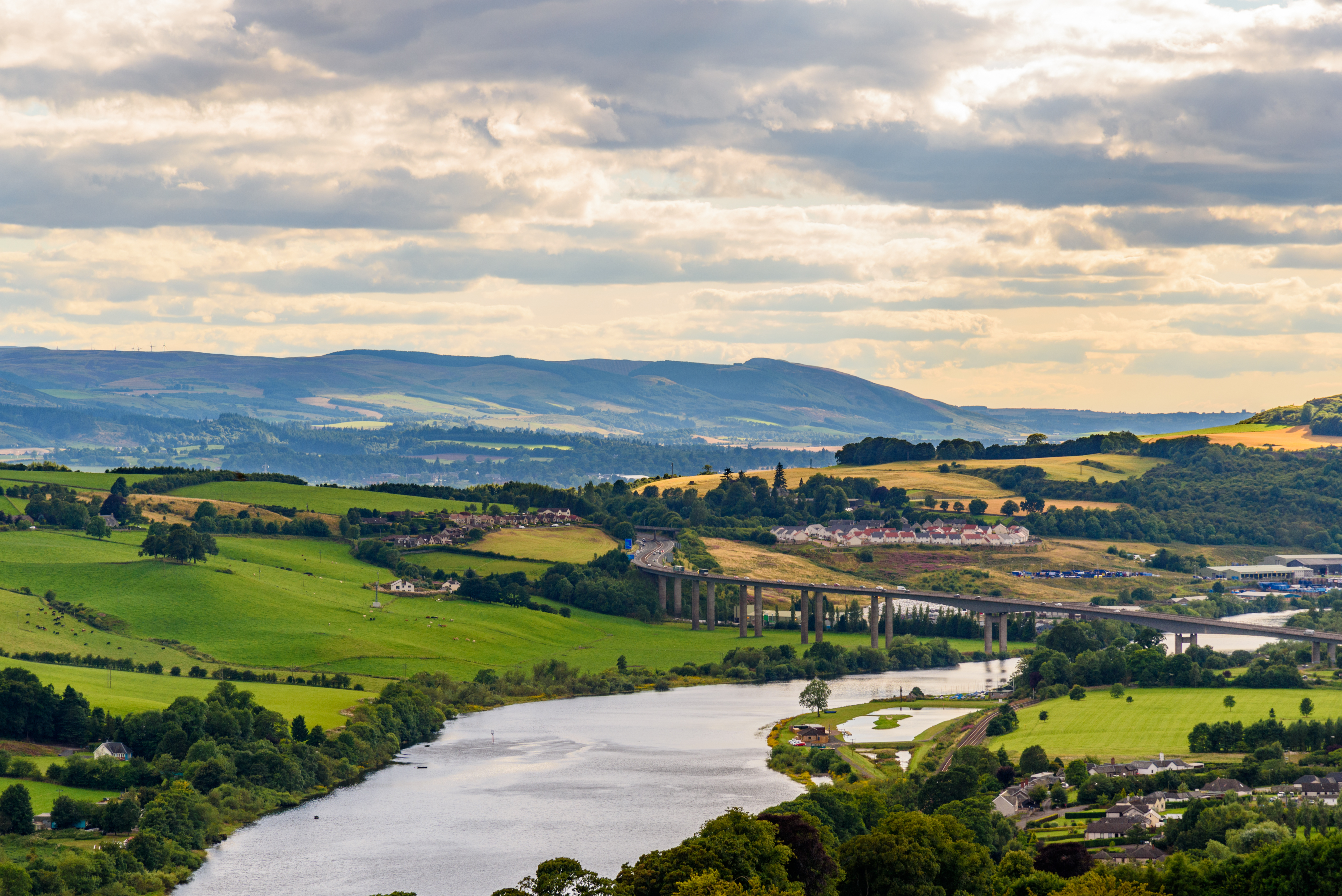 View of hills, fields, a large road and a wide river near Perth in Scotland