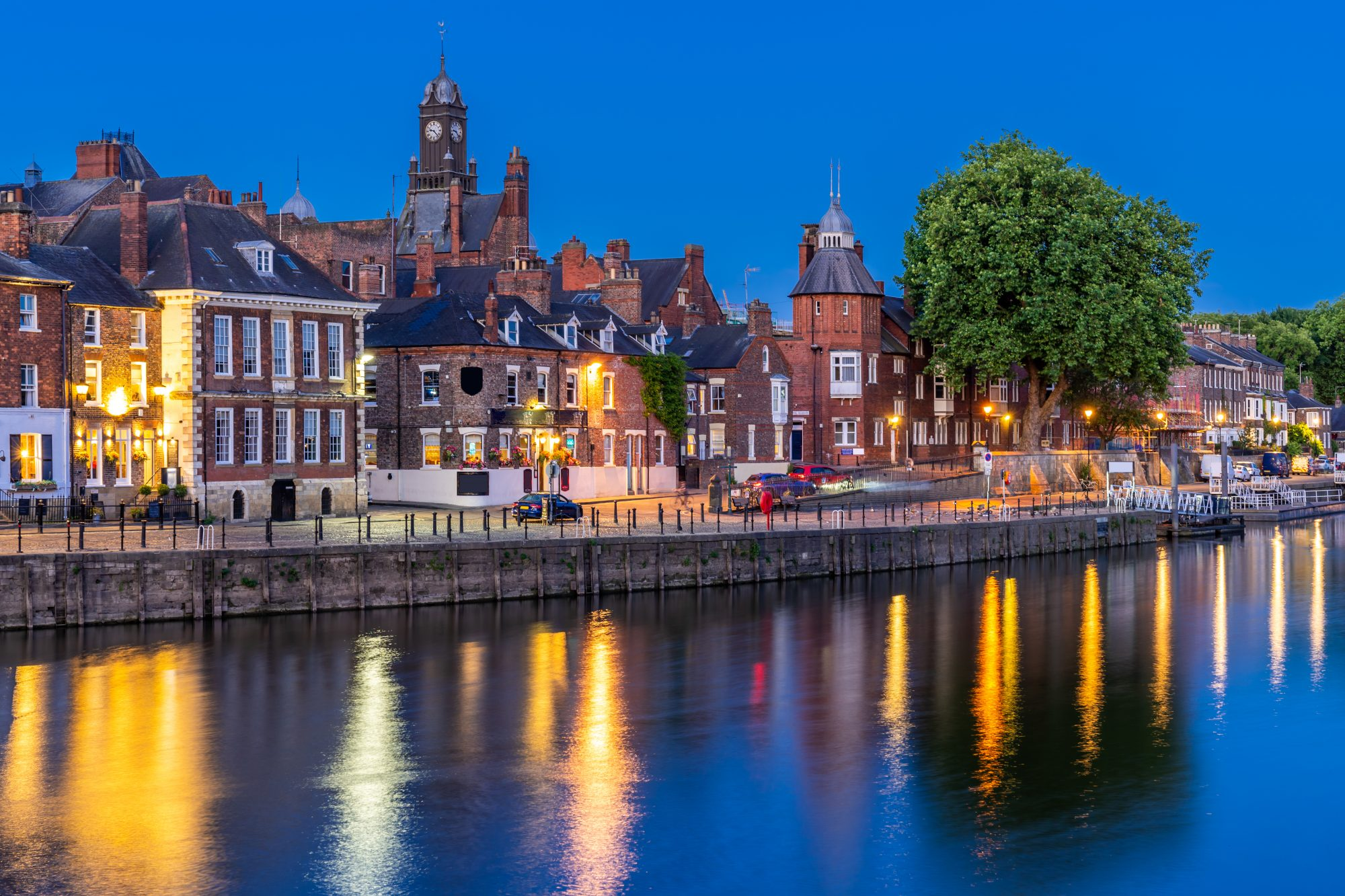 Dusk image of old brick buildings along the River Ouse in York