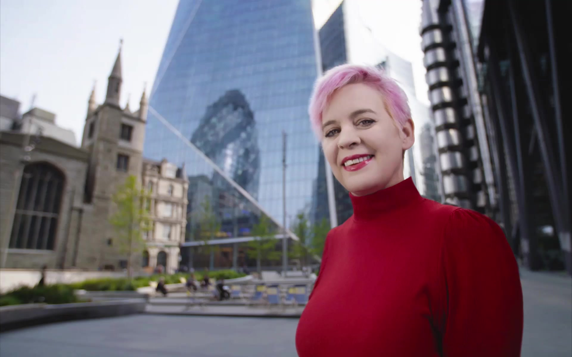Woman outside Aviva headquarters in London smiling at the camera